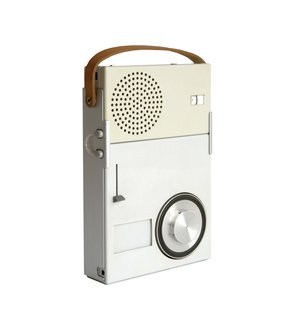 Portable Transistor Radio and Phonograph by Dieter Rams for Braun  With a compact, rectilinear body, Rams's 1959 Functionalist design heralded the now-ubiquitous notion of personal music on-the-go.
