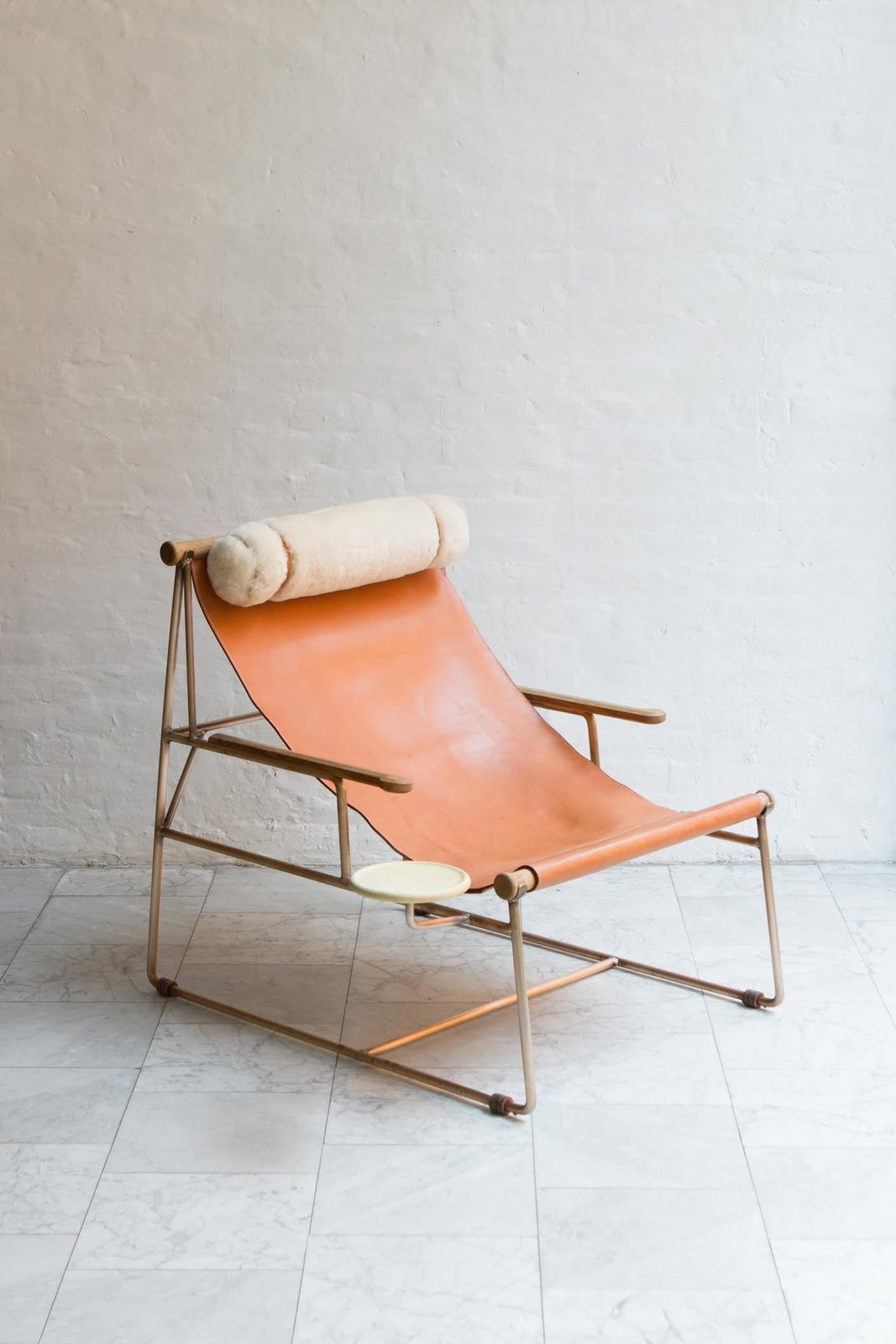Deck Chair by BDDW, $5,880  Made at BDDW's Philadelphia workshop, this generously proprortioned chair is made from a leather sling seat, metal, frame, and shearling head cushion. A small circular tray begs for an ice-cold drink (beer coozie not included).  Photo 3 of 10 in Favorite Chairs