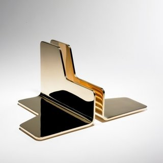 Prop bookends by Jonathan Nesci, priced upon request  Made by Columbus, Indiana–based industrial designer Jonathan Nesci, these handsome bookends are made from mirror-polished bronze (shown) or stainless steel.