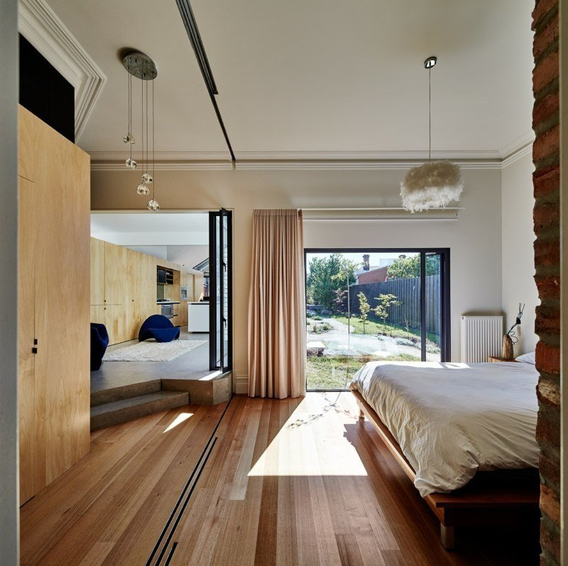 Three plywood veneer sliding doors separate the bedroom from the hallway.  Cut Cut Paw Paw by Allie Weiss