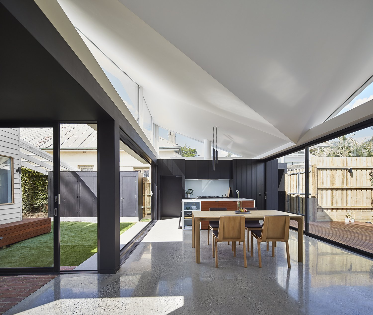 """""""Natural light was not great in this house,"""" Ong says. """"So it was important that we came up with a concept that allowed natural light to flow through the new extension and also to the existing front part of the house.""""  Breeze by Kelly Dawson"""
