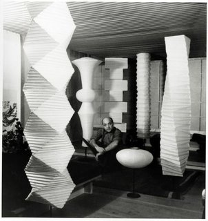 Isamu Noguchi, pictured here in 1960 with his Akari floor lamps.