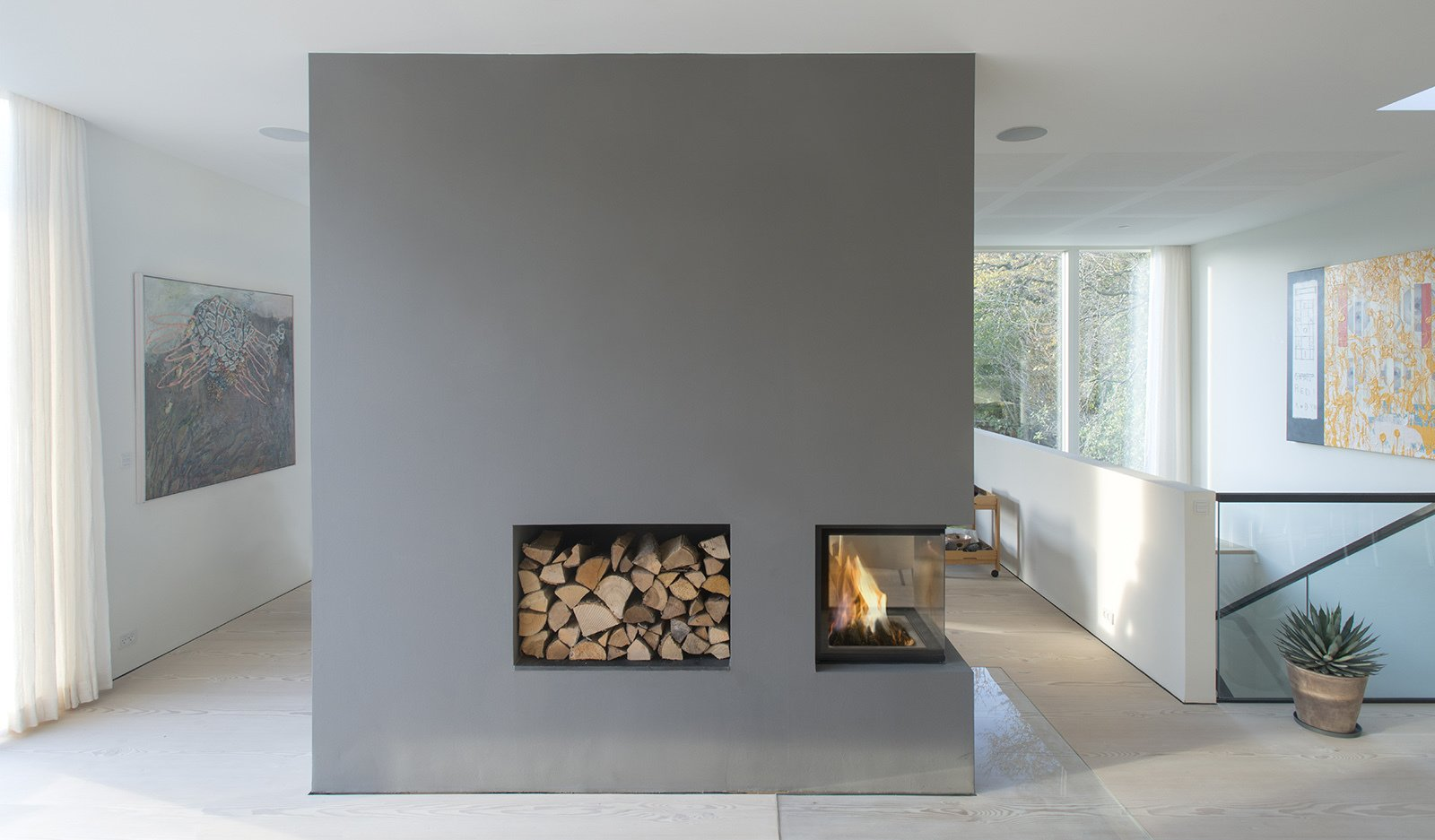 A three-sided fireplace offers warmth.  97+ Modern Fireplace Ideas from Villa R
