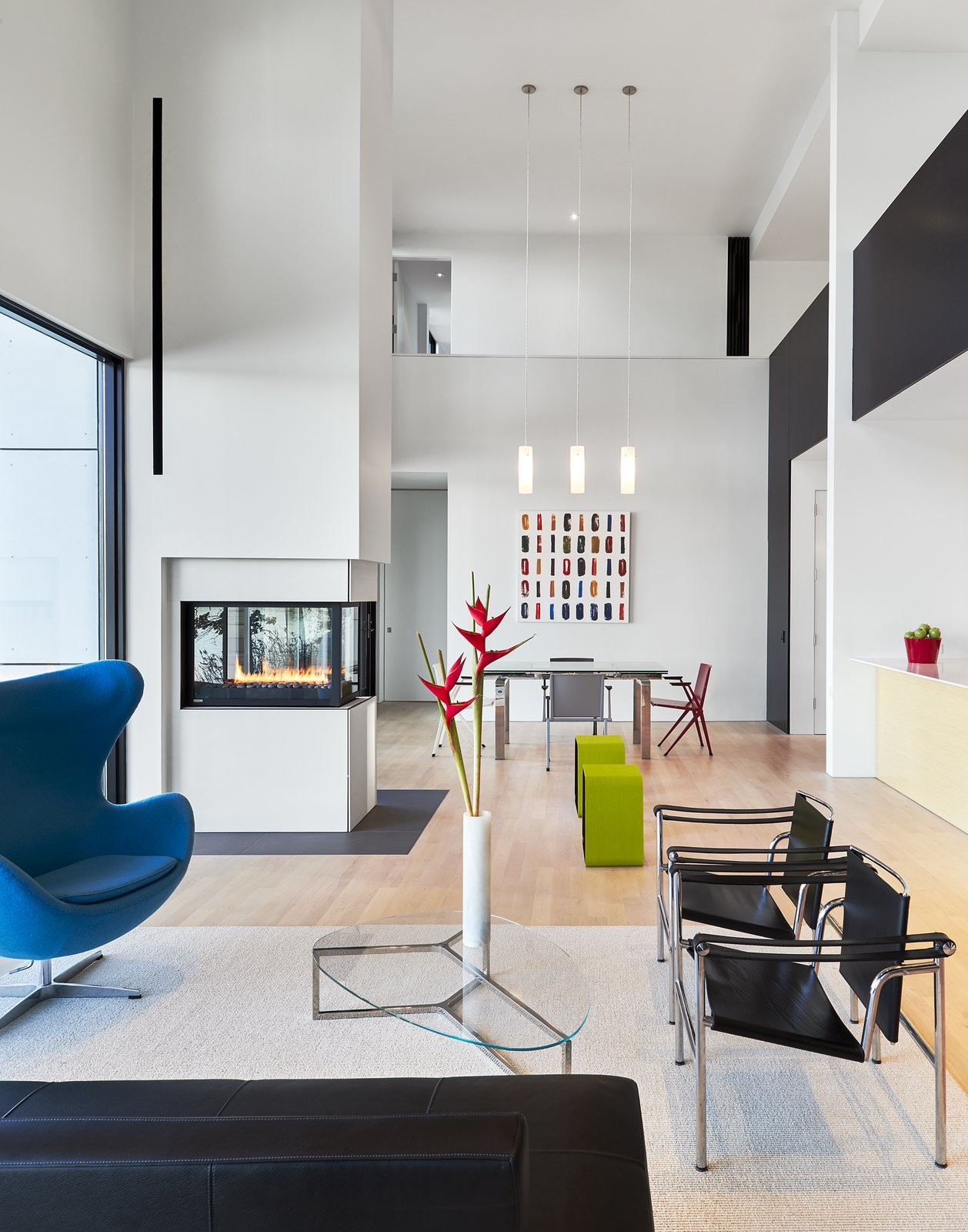 Photo 9 Of 10 In Fritz Hansen Egg Chair From Splashes Of Color Enliven An Abstract Painter S Crisp White Home Dwell
