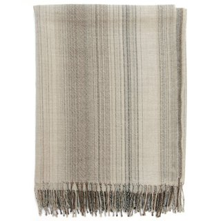 The Jack Neutral Throw Blanket offers unparalleled velvety softness in a striped pattern that telecasts understated chic. Warmer than wool and more durable than cashmere, these blankets are made from the finest alpaca fibers in rich natural colors.