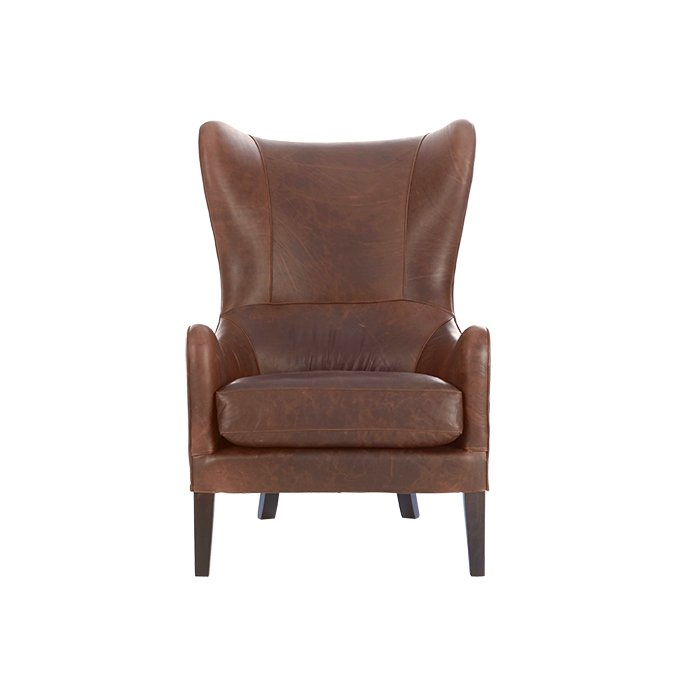Wing chair by James Harrison for West Elm, $1,299  A leather seat, like this streamlined version of a wing chair, works like a tailored jacket: It matches everything and looks better with age.  Photo 4 of 5 in Editors' Essentials: 5 Excellent Easy Chairs