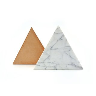 White marble triangle trivet by Fort Standard, $88 from store.dwell.com.