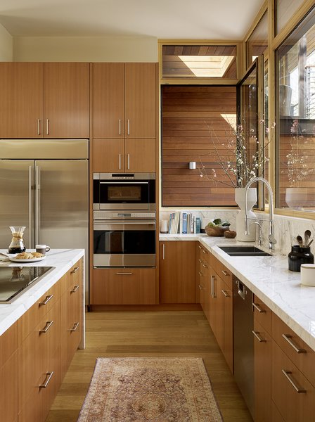 In addition to Wolf and Sub-Zero appliances, the kitchen features an on-demand hot water recirculation pump that reduces wasteful water heating. Schwinn cabinet pulls adorn the custom cabinetry and the K7 faucet is from Grohe.