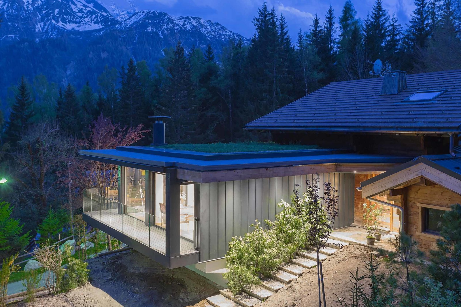 Exterior, Green Roof Material, and House Building Type Situated on a natural promontory in Coupeaux, France, the home's plan and expansive windows open it to the beautiful surroundings outside.  Photo 1 of 8 in A Mountain Hideaway Plants a Green Roof in the French Alps