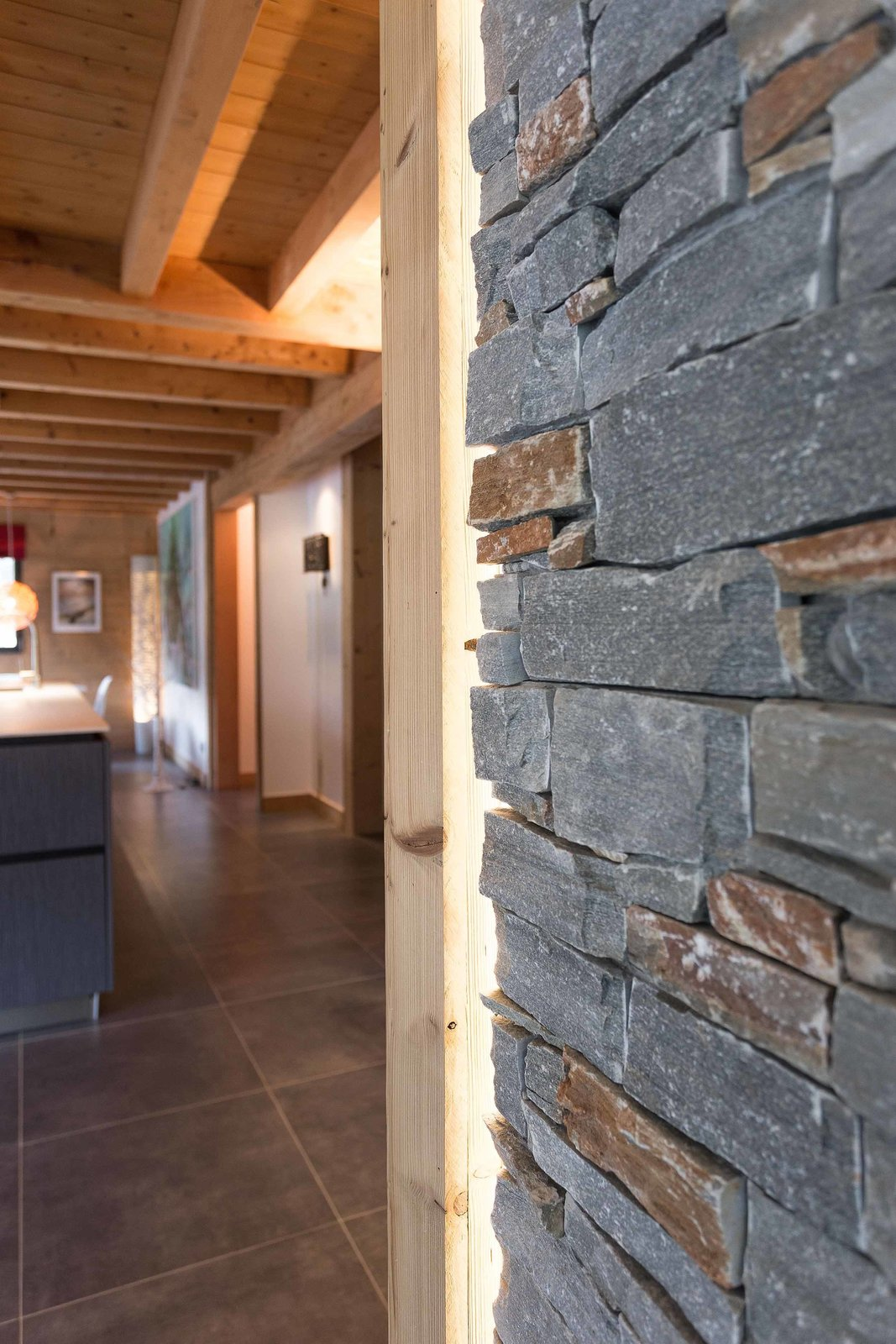 Wood and stone elements add to the rustic atmosphere inside, resulting in a home that feels like a natural extension of the landscape.  Photo 7 of 8 in A Mountain Hideaway Plants a Green Roof in the French Alps