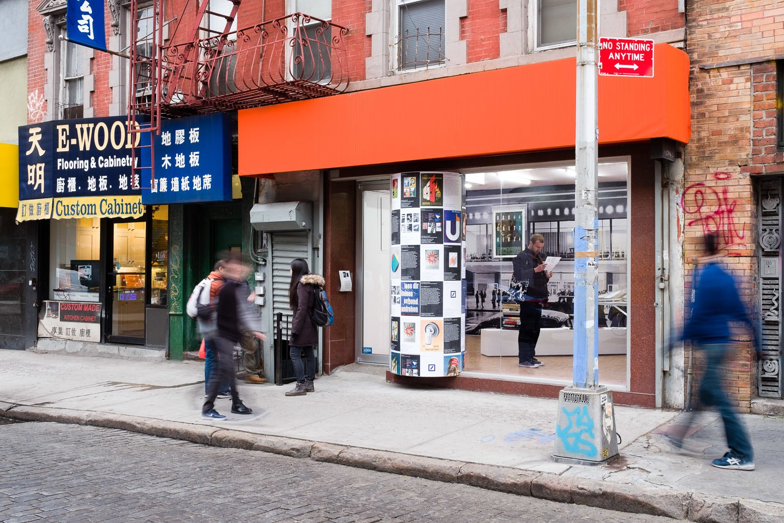 """As part of the exhibition display, Krishnamurthy installed a large poster column that protrudes from the gallery's storefront facade. """"Klaus Wittkugel believed in the street as a primary context for graphic design: a large portion of his work consisted of posters, meant to catch your eye while walking. As P! is in Chinatown and has a very public presence, I decided to extend this gesture and make it a key feature of the exhibition,"""" he says. """"In Berlin, you still see a lot of Littfasssäulen, a distinctive and typical kind of poster column. Together with Cay Sophie Rabinowitz, curator of the parallel exhibition on Anton Stankowski at OSMOS, I conceived an installation that would display reproductions of work by the two Cold War designers together. There is also a second poster column at OSMOS, which is the 'umbilical cord' between these two otherwise independent exhibitions. The installation echoes Wittkugel's own approach to his retrospective exhibition in 1961, when he covered the poster columns in the city with a selection of his past work, along with the posters announcing the show. Artist Maayan Strauss had the brilliant idea of making the poster column 'break out; of the gallery, so that it seems to literally cross over a border. Wittkugel's first job was as a window-dresser, so it's an appropriate homage to have this kind of attention paid to the storefront window.""""  Photo 6 of 6 in A Look at Klaus Wittkugel, East Germany's Most Prolific Graphic Designer"""