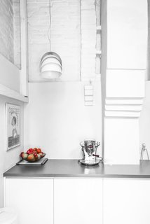 A bright corner in the kitchen houses an Electra coffee maker and a quirky pendant lamp by Lightyears.