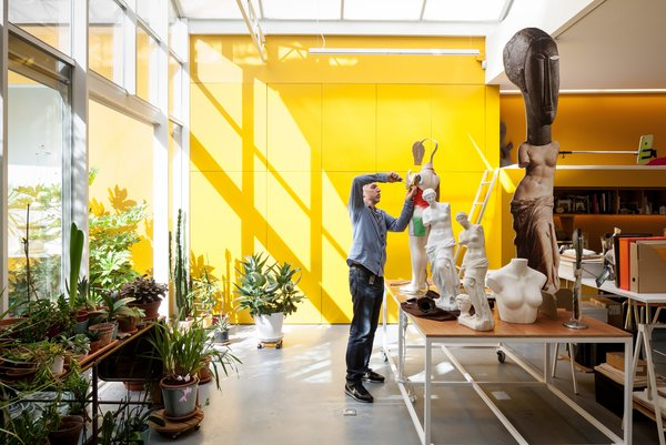 Here Tim tinkers with works-in-progress in his studio space, situated across the courtyard from Nathalie's.