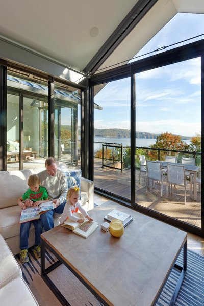 The living room and a deck offer expansive views of Table Rock Lake.