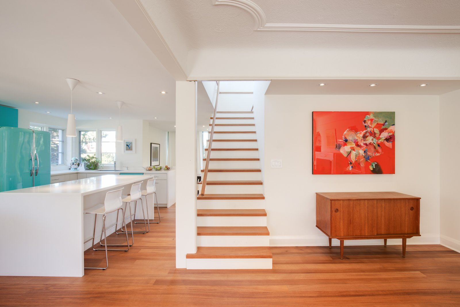Benjamin Moore's Cloud White paint color, which was used throughout the home, lets the African mahogany flooring stand out.  Art Moderne by Kelly Dawson