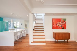 Benjamin Moore's Cloud White paint color, which was used throughout the home, lets the African mahogany flooring stand out.