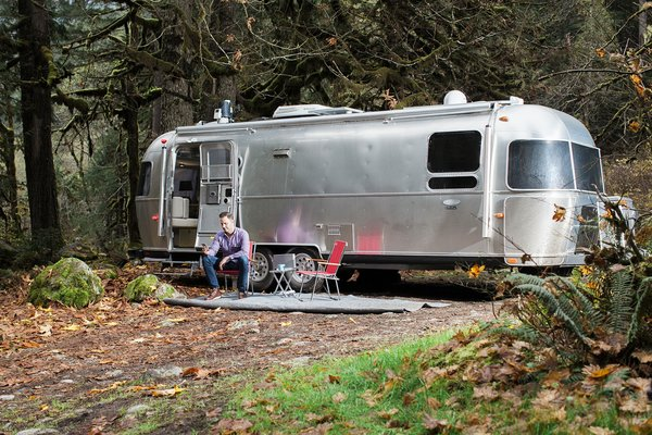 """When Pendl wanted a second home for road trips, Airstream was the clear choice: it matched his own love for modern and industrial aesthetics. He picked the International Sterling model for its especially contemporary interior, what he calls """"a sleek...interpretation of that classic Americana style."""" But there was a hitch: this retro-futuristic dwelling couldn't support present-day security systems.  Due to due to liability concerns, security companies won't typically install their products homes on wheels. Luckily Pendl already had some experience with smart technology systems: """"Home automation has been on my radar for quite a while. Initially I was drawn to just the ability of being able to turn things on and off remotely, then I began to play with...[making] a smart home."""" In 2014 he learned about Wink, an app that lets users manage their smart home devices like Nest, Honeywell, Canary, and Phillips Hue. He set about improving his home in Seattle, first with just a few smart light bulbs then """"I organically grew my ecosystem of products from there."""""""