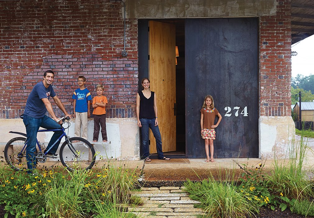 Architect David Hill, his wife, Elizabeth, and their three children (from left: Wade, eight, Luke, six, and Breyton, ten), have an unusual home by the standards of their college-town setting in Auburn, Alabama. Built in 1920, the industrial brick building has had previous incarnations as a church, a recycling center, and a pool hall, among others.  Brick Houses from Around the World  by Matthew Keeshin