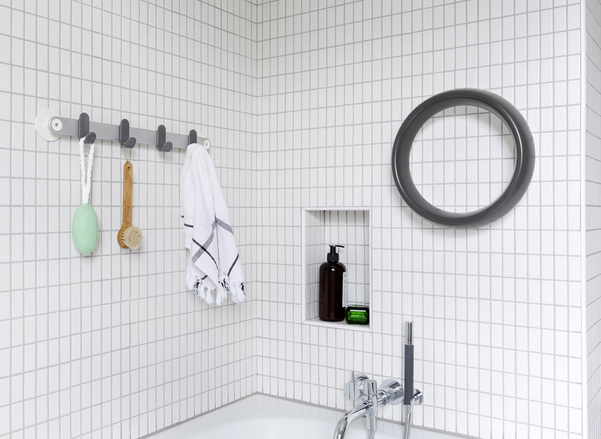 """Sabi's aluminum towel bar with hooks comes in two lengths and retails for $80 and $100. The grab bar ($150) is an unusual circular shape that's easy to grip from any angle. The powder-coated aluminum delivers a """"strong, secure, reassuring grip.""""  Photo 5 of 6 in Universally Easy Bathroom Accessories Ideal for Renovators of All Ages"""