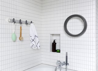 """Sabi's aluminum towel bar with hooks comes in two lengths and retails for $80 and $100. The grab bar ($150) is an unusual circular shape that's easy to grip from any angle. The powder-coated aluminum delivers a """"strong, secure, reassuring grip."""""""