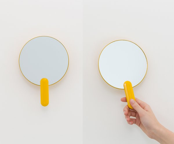 Sabi's wall-mounted detachable hand mirror ($50) magnifies two times and is encased in cheery yellow or neutral gray.