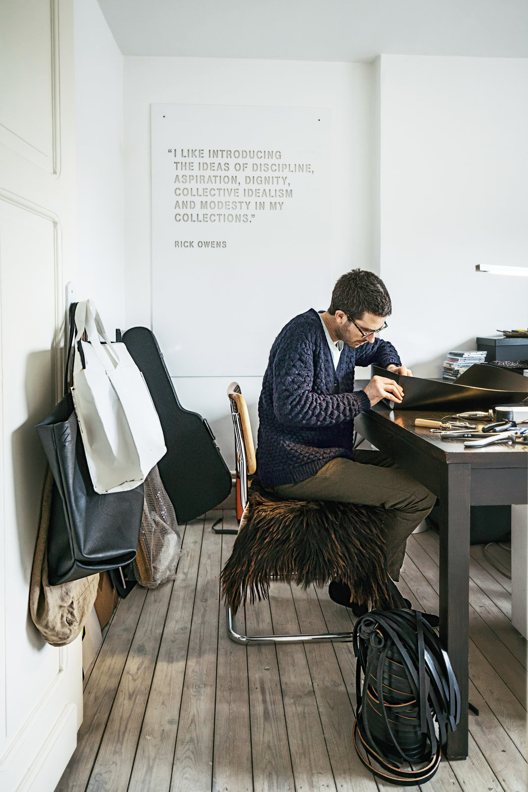 Office, Medium Hardwood Floor, Study Room Type, and Desk Verheyden works at his desk in the home office; over-flow projects are tackled in the workshop adjacent to the house, which is covered in black wood.  Photo 2 of 8 in A Clever Belgian Couple Renovate Their Aging Brick Home