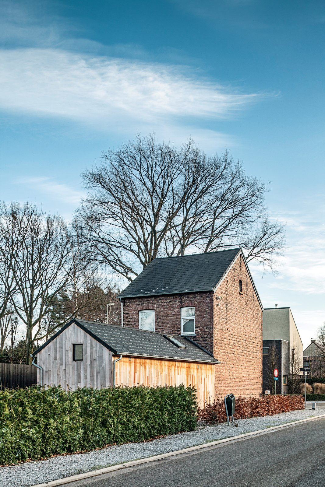 The facade is original to the 1930s house, and the couple rebuilt the annex, which houses the kitchen and bath.  Photo 7 of 8 in A Clever Belgian Couple Renovate Their Aging Brick Home