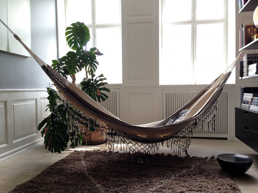The color palette may be restrained, and the price tags high, but it's not all serious: Check out the hammock hung in the office between the living room and bedroom.  Modern Danish Homes We Love from Restrained Color Palette and Rich Textures in Copenhagen Furniture Showroom