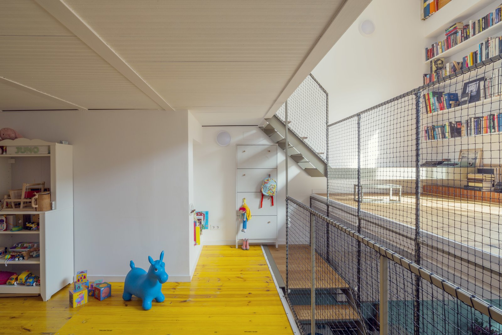 """By creating so much open space, the family can feel connected even while on separate floors. """"We were looking for an easy and fast connection among the four levels,"""" says the firm.  A 16-Foot-Wide Barcelona Row House Gets Creative to Stay Bright and Airy by Alex Vuocolo"""