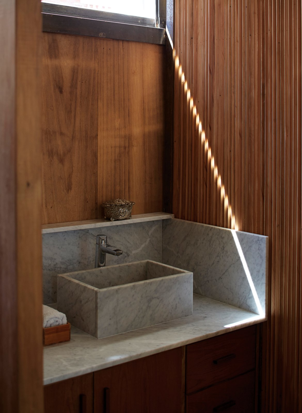 Bath Room, Marble Counter, and Vessel Sink A Carrara marble sink in the bathroom is surrounded by Brazilian pine and cypress.  Bathroom from One-of-a-Kind Furniture Fills This Delightfully Serene Buenos Aires Home
