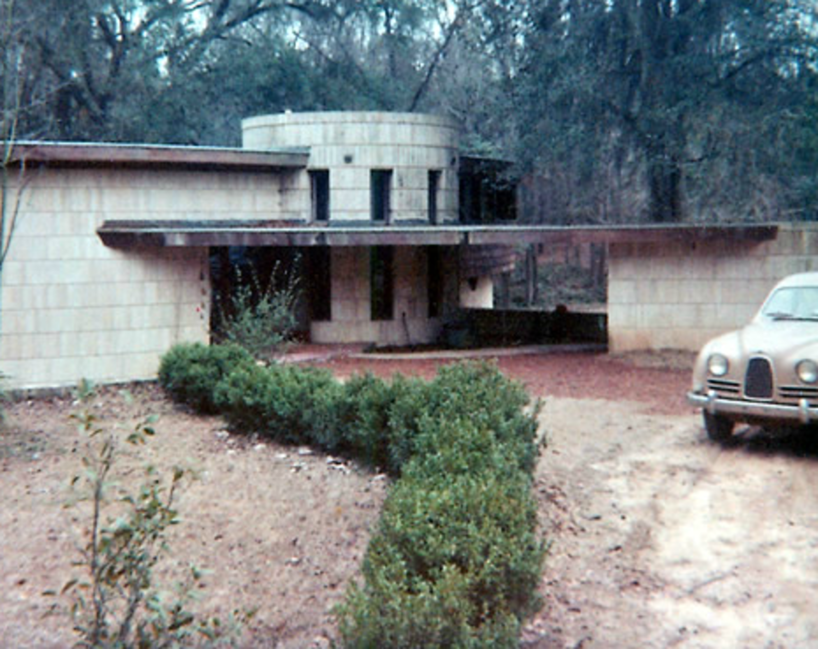 The Spring House was placed on the National Register of Historic Places on February 14, 1979. Pictured here is the home as viewed from the street.  Frank Lloyd Wright's Endangered Spring House  by Allie Weiss