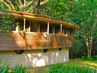 "Frank Lloyd Wright's Spring House in Tallahassee, Florida, was commissioned by George and Clifton Lewis, who sought a comfortable house for their large family that fit within their modest budget. Completed in 1954, the home features an unusual ""hemicycle"" form—a shape that the designer briefly experimented with at the end of his career. Now, a fundraising campaign aims to acquire, restore, and open the house to the public."