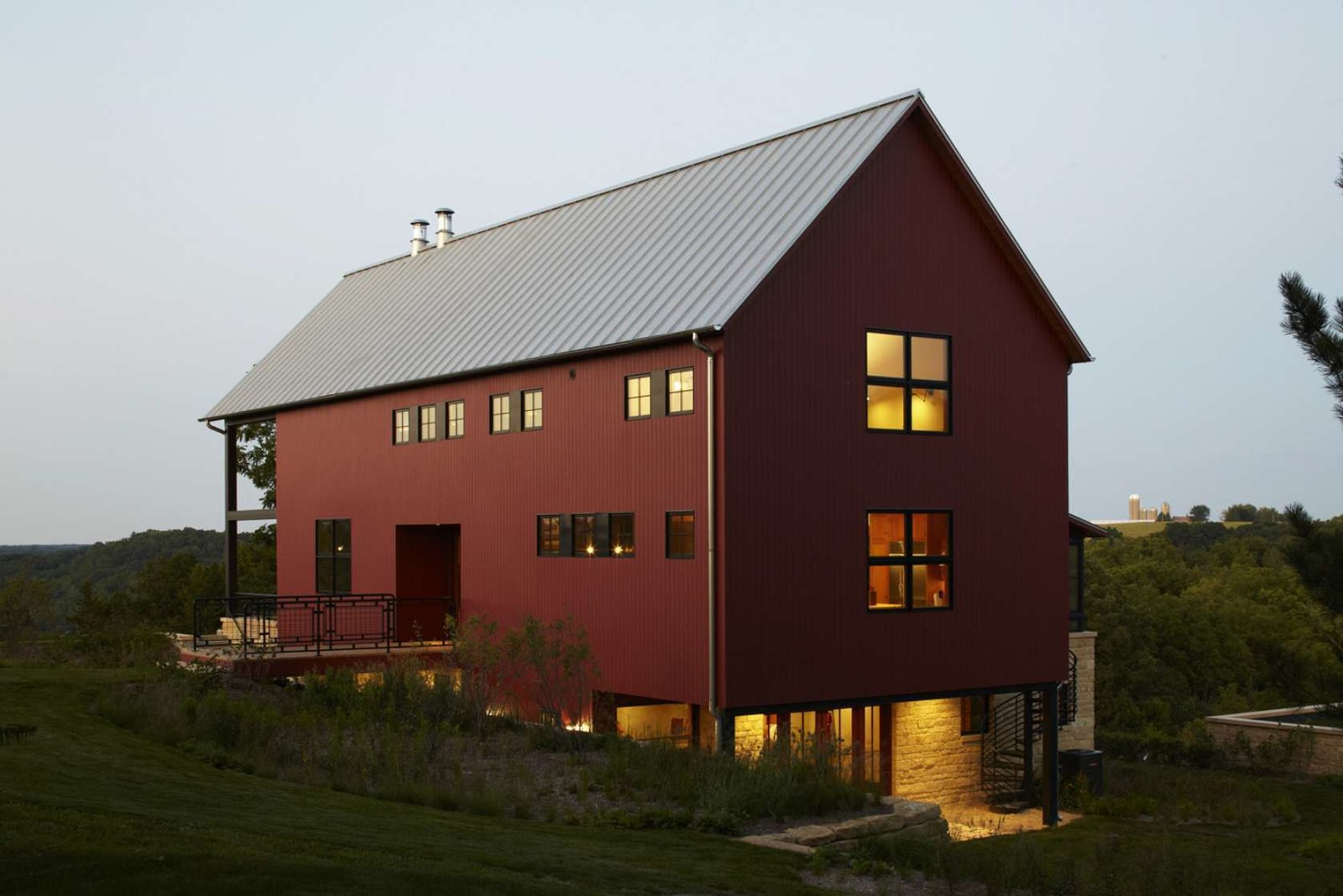 """Exterior, Barn Building Type, Wood Siding Material, and Metal Roof Material From red painted cedar siding to no-fuss structural elements, Northworks' solution reaches a happy medium between the classic barn look and a weekend retreat. """"The best thing about this house,"""" explains one resident, """"is that when it's just the four of us, it feels cozy. But even when we're hosting 25 people, it never feels crowded.""""  Search """"mvrdvs balancing barn"""""""" from A Family Salvages an 1880s Barn to Create Their Nearly-Net Zero Escape"""