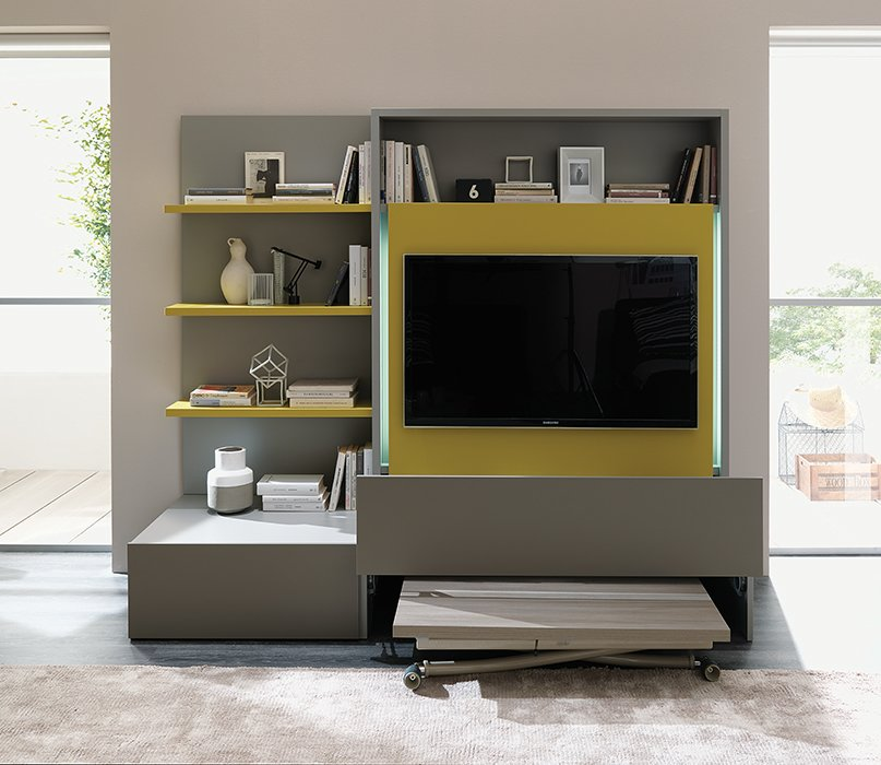 A freestanding Smart Living media unit conceals a complete dining set for six behind the television.  Micro-Hotel Suite by Resource Furniture at Dwell on Design by Allie Weiss