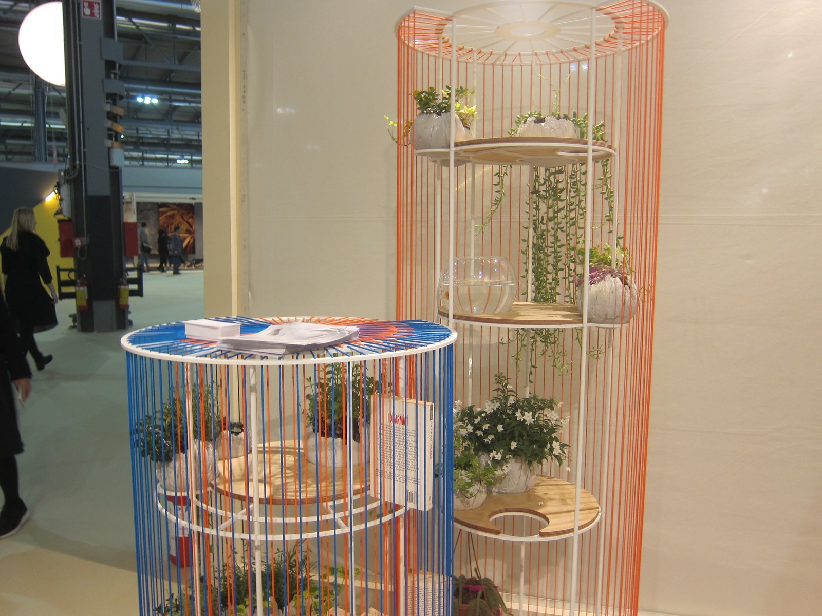 Ale Meacci's colorful shelving system collapses into a flat ring for easy moving—and can be used indoors or out.  What's Next in Design: Highlights from Salone Satellite's Emerging Designers by Heather Corcoran