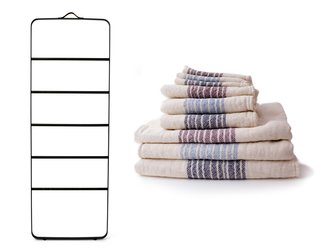Towel holder by Menu in black with dark oak, $499.95 from dwell.store.com, and Flax Line organic bath towels by Kontex, $13-$67 from store.dwell.com.