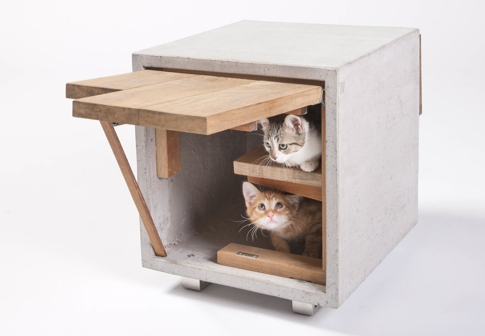 The Cat Cube by Standard Architecture | Design of Los Angeles has two openings and is made with reclaimed wood and concrete. The concrete heats up during the day to provide strays with a source of warmth at night.  Photo 21 of 21 in 21 Cats Living in the Modern World from Cats–At Home in the Meow-dern World