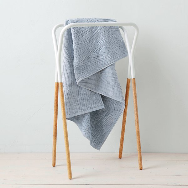 Modern Two-Tone towel rack by West Elm, $49 A perky rack with a straightforward purpose and a price to match. The wood can help add a warm touch to a cold bathroom.