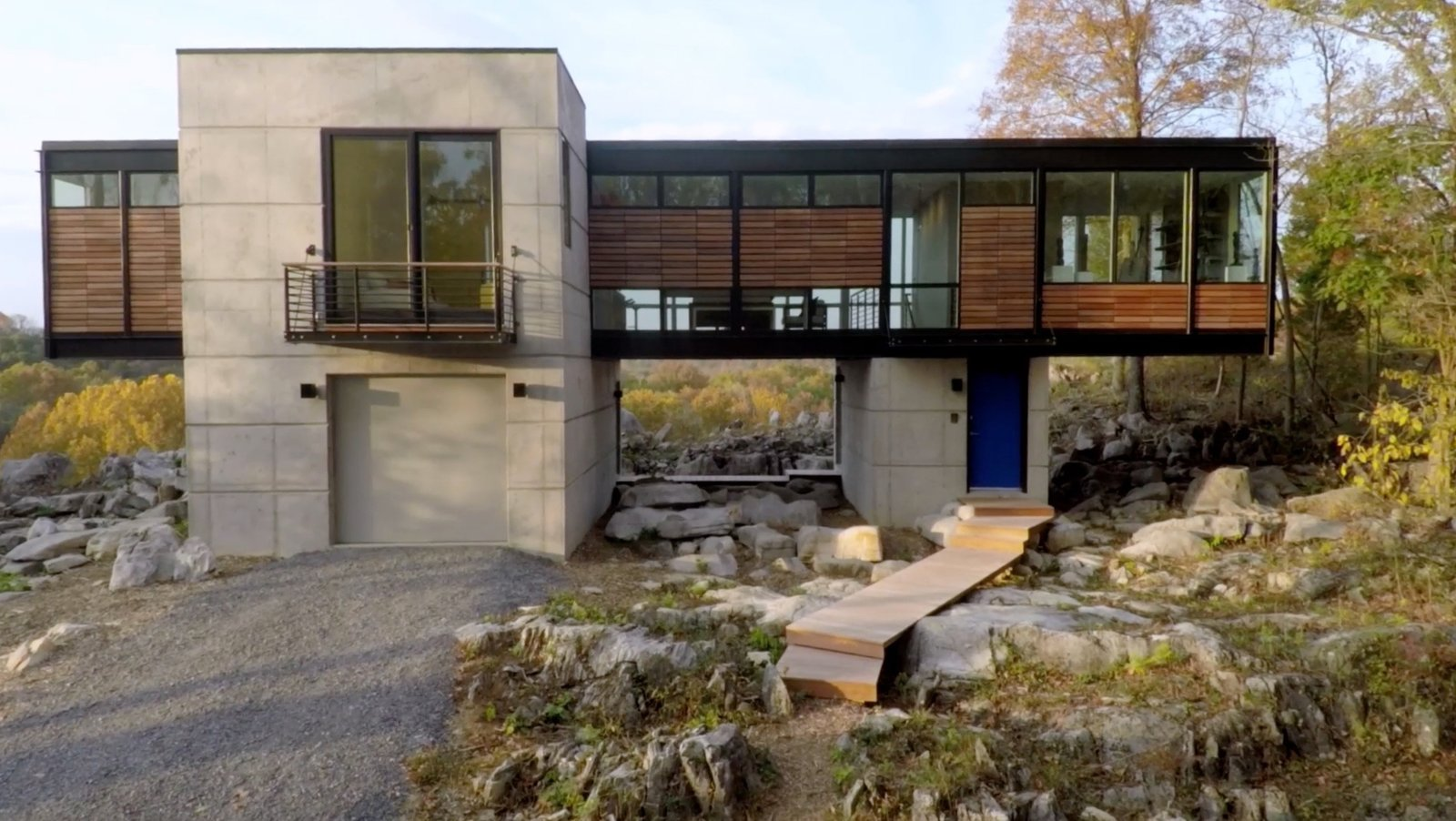 Strait envisioned a house that was molded into its surroundings and that disrupted the landscape as little as possible. Similar to her work, the structure delicately touches down in an organic way. When they were developing the plans on-site, they were successful at moving only the bare minimum of existing boulders.  Photo 2 of 5 in Watch How a Sculptor's Cliffside Glass House Seems to Grow Out of the Rocks