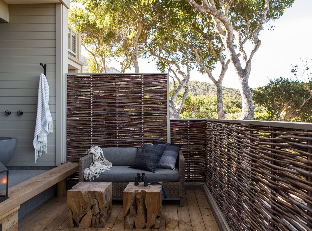 The 12 new suites range from 400-600 square feet, including an outdoor living area. The sofa and occasional tables are from Restoration Hardware and the proch railing is made from woven willow branches.  A Serene Hotel in Carmel, California by Diana Budds