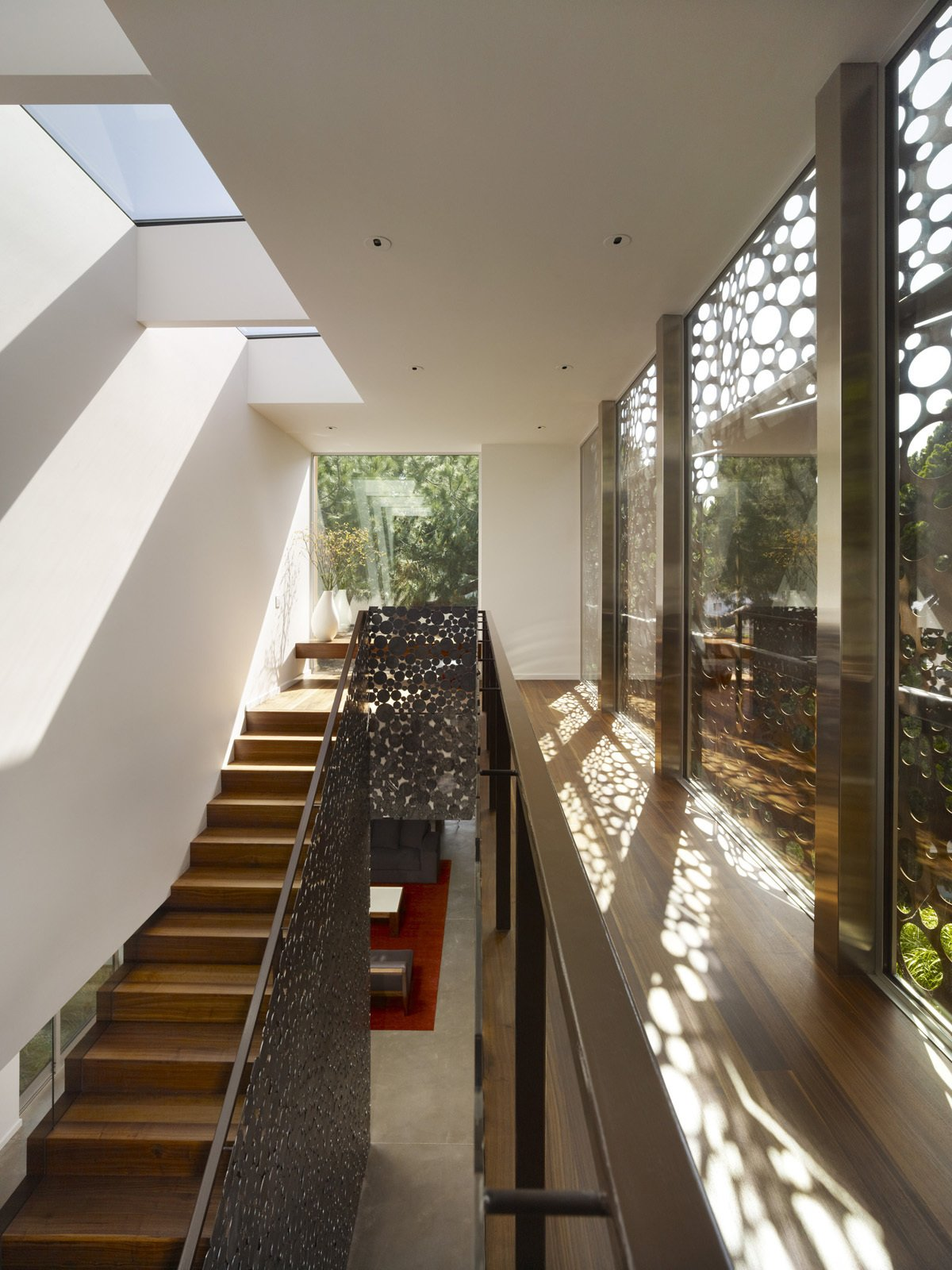 """In stark contrast to Monti's 1920s home now being rented out, the Walnut Residence never seems to run out of natural light. """"After six months of living here, my wife and I noticed that we never turn on the light,"""" remarked Monti. """"I never have to turn on the light—ever.""""  Ways to Incorporate Trees into Homes by Diana Budds"""