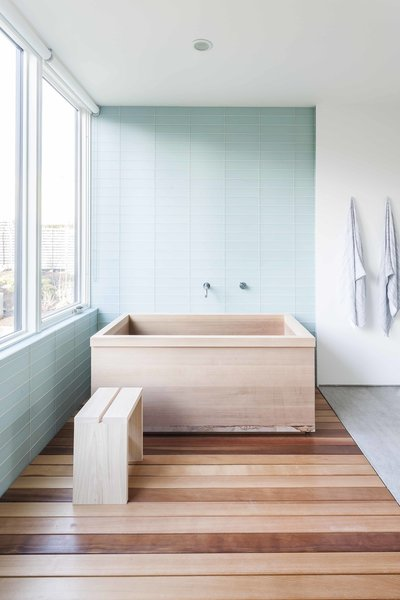 The custom cedar tub, fabricated by Dovetail, elegantly fits into the master bathroom.