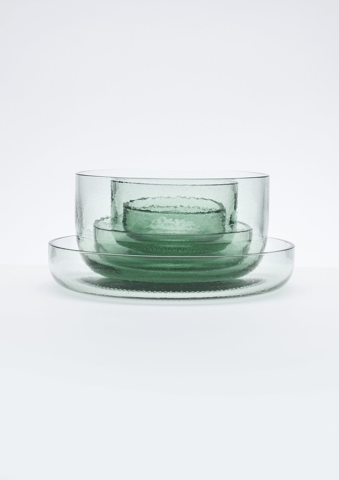 A glassware collection by Nendo made from recycled Coca-Cola bottles.  Photo 5 of 9 in New York Design Gallery Chamber is a Cabinet of Curiosities