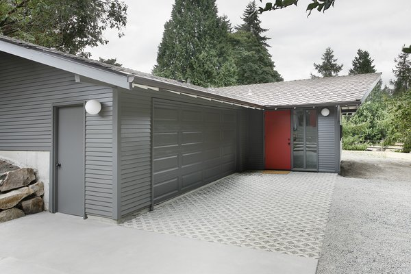 """""""The stable/garage was built with two intersecting gable roof forms,"""" Schaer says, which didn't match up with the inteiror spaces within. """"In order to provide a unified, singular main space, we dropped a flat ceiling at the entrance and linked it up with the main gable visible from the street."""""""