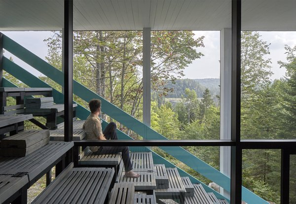 A south-facing wall of windows allows for spectacular views and maximizes passive solar heating.