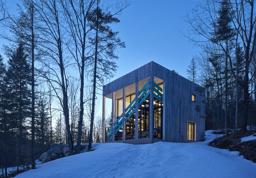The home's cubed shape keeps the footprint small, while the overhang was designed to accommodate the changing angle of the sun. It prevents overheating in summer while admitting as much winter sunlight as possible.  Cabins & Hideouts