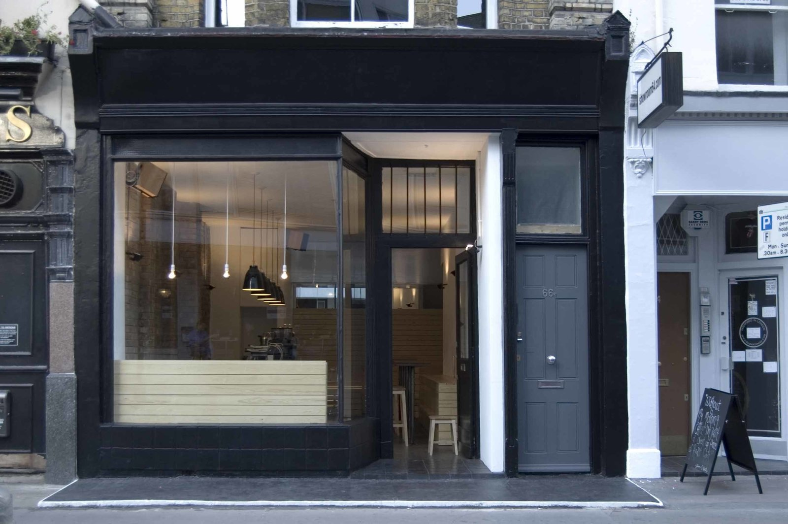 Outdoor Kaffeine  Tozer refurbished the interior and exterior of this tiny retail space in Fitzrovia, preserving the existing shopfront and painting it jet-black.  The Architect Behind Some of London's Homiest Coffee Shops by Luke Hopping