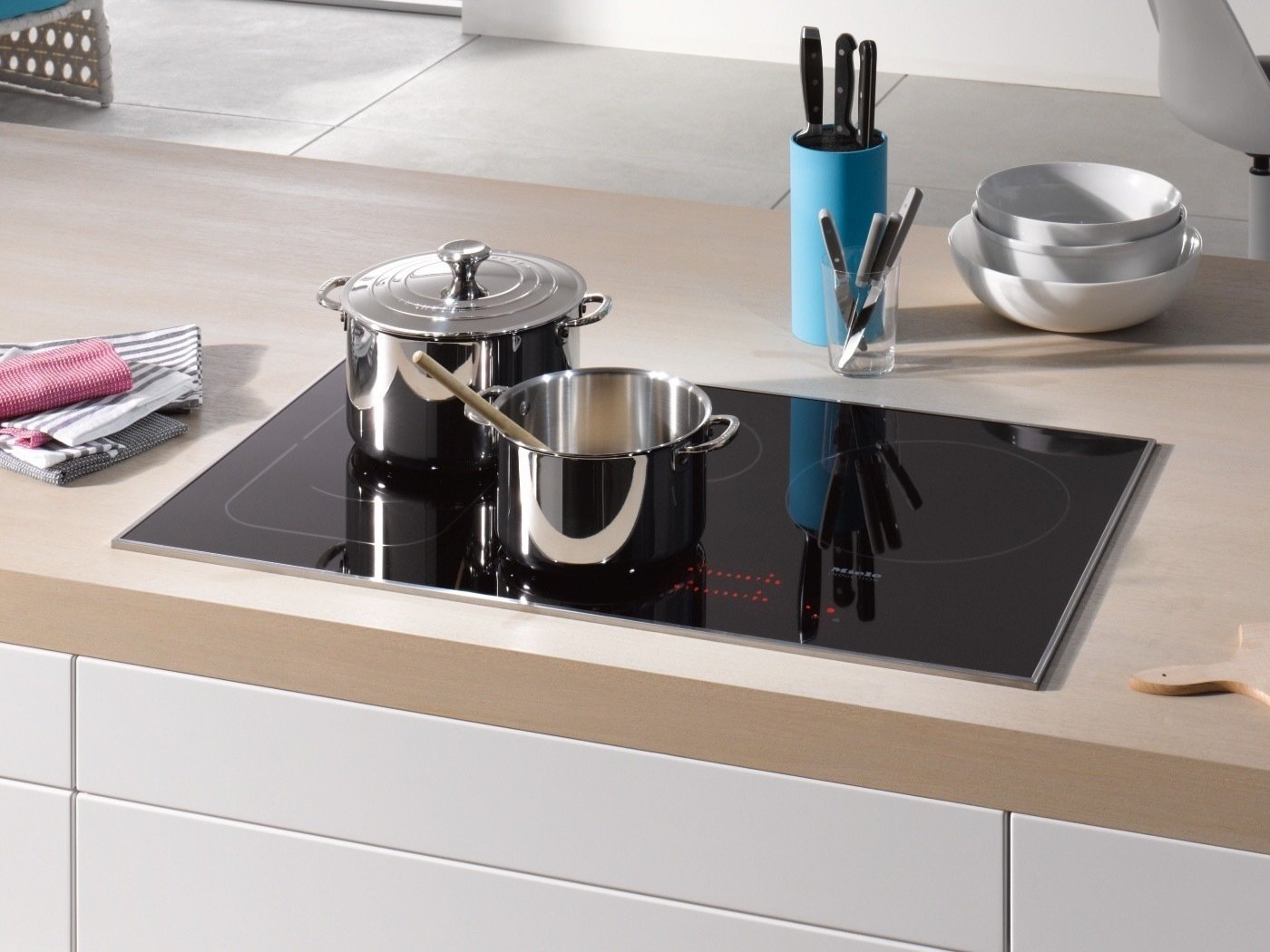 If all that isn't enough, the extra capabilities will blow you away. Most notably, you'll be happy to find an automatic heat-up option, a precise timer, variable cooking zones, safety shut-off functions, intuitive control panels, pan size recognition, and an EasyClean Ceran surface that's designed to resist heat transfer.  Photo 4 of 4 in The Possibilities Are Endless With This New Cutting-Edge Cooktop