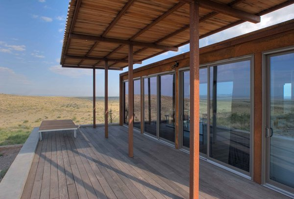 Large canopies shade the retreat's southern elevations, rendering the interior and ipe wood patio comfortable in the Texas heat.