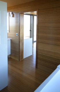 The interior walls and floors are carbonized bamboo; this material consists of regular bamboo flooring treated with steam to create a darker and richer color.